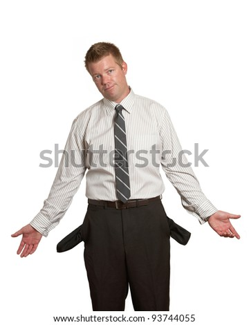 Handsome man in suit broke with empty pockets on white - stock photo