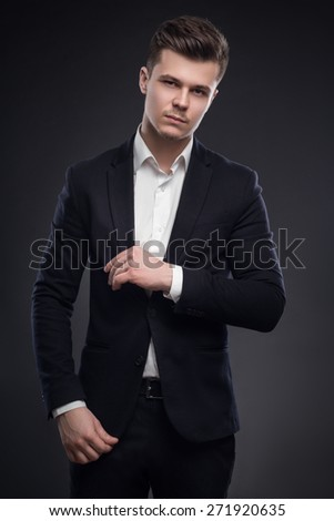 Handsome Man In Suit On Black Background - stock photo