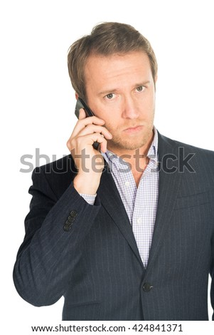 handsome man in suit speaks on the mobile phone isolated