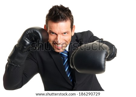 Handsome man in suit with boxing gloves on his hands - stock photo