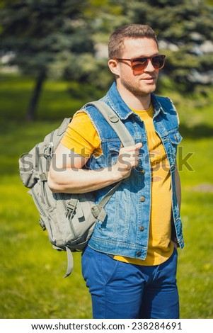 Handsome  man in the green park - stock photo