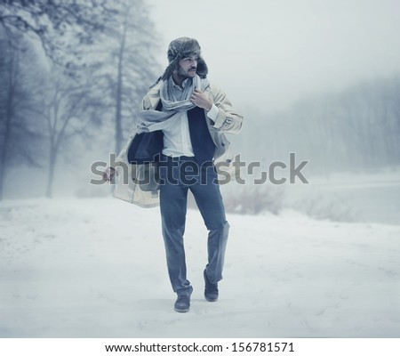 Handsome man in winter scenery