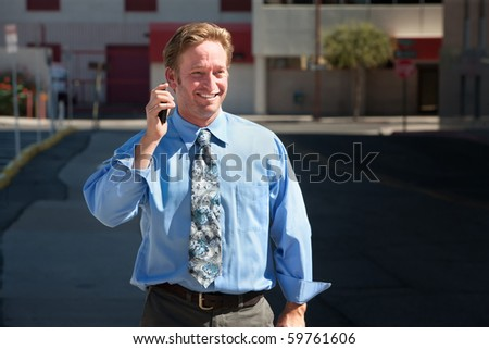 Handsome man is happy with his phone call. - stock photo