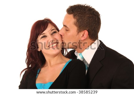 Handsome man kissing his beautiful smiling girlfriend's cheek