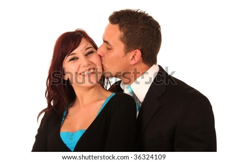 Handsome man kissing his smiling girlfriend on her cheek