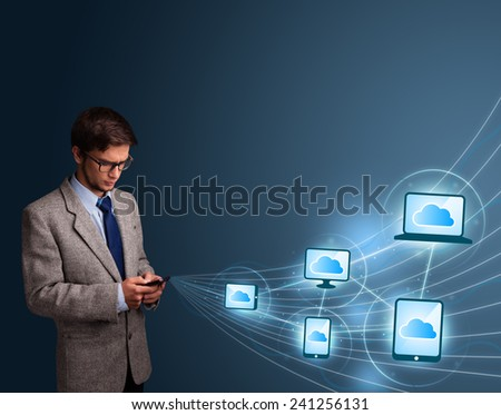 Handsome man lady typing on smartphone with cloud computing - stock photo