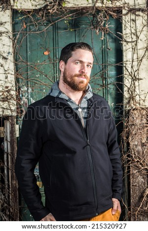 Handsome man late 20u0027s with big beard and blue eyes in front of a garage door  sc 1 st  Shutterstock & Handsome Man Late 20s Big Beard Stock Photo 215320927 - Shutterstock pezcame.com