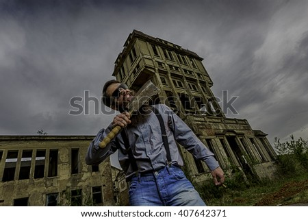 handsome man lick cleaver with old building