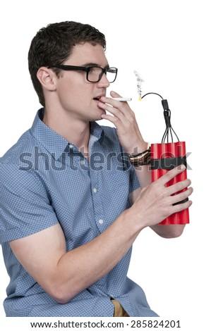 Handsome man lighting a cigarette with dynamite - stock photo