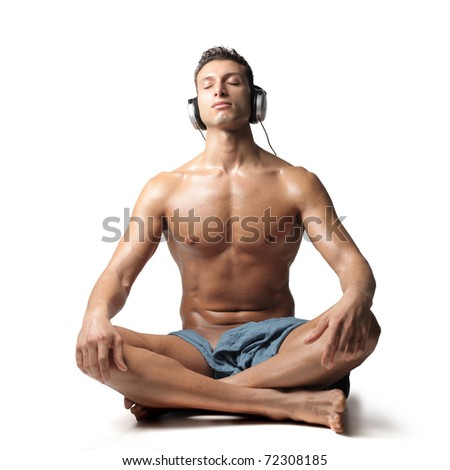 Handsome man listening to music - stock photo