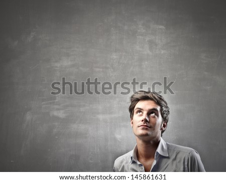 handsome man looks up - stock photo