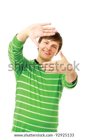 Handsome man making frame with his hands isolated - stock photo