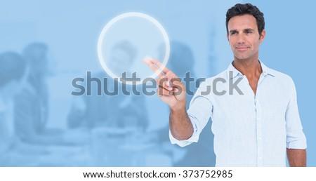 Handsome man making gun gesture against blue background - stock photo