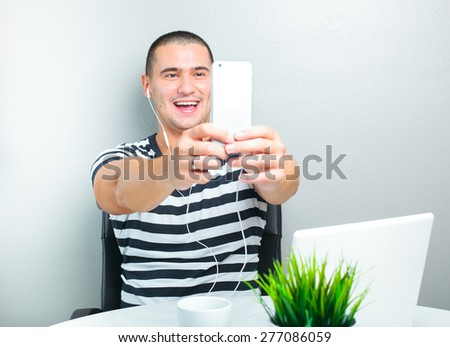 handsome man making selfie - stock photo