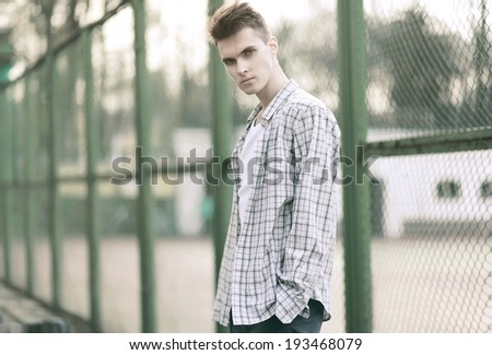 Handsome man model with deep look in urban style, hip-hop, street fashion, vintage photo - stock photo