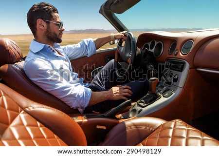 Handsome man near the car. Luxury life. - stock photo