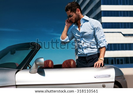 Handsome man near the car. Luxury life. Business. - stock photo