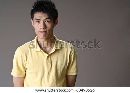 Handsome man of Asian looking towards camera with copyspace. - stock photo