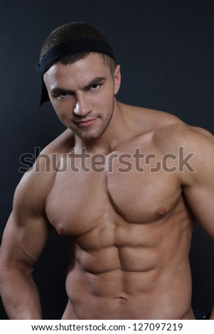 handsome man on a black background - stock photo
