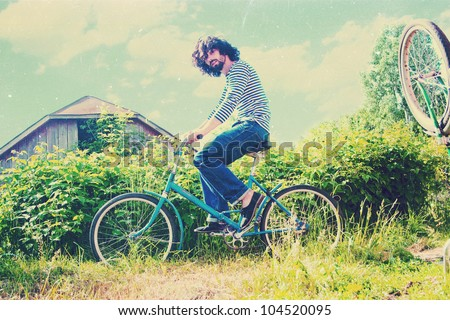 handsome man on bicycle, art image - stock photo