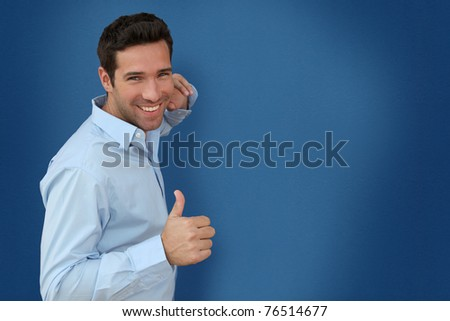 Handsome man on blue background - stock photo