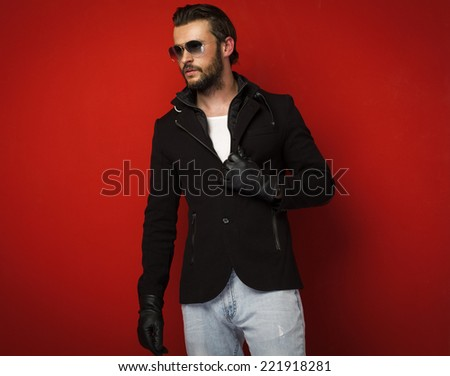 Handsome man on red background - stock photo