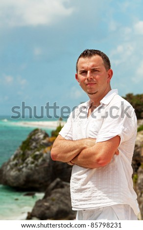 Handsome man on the cost of Tulum - Mexico - stock photo