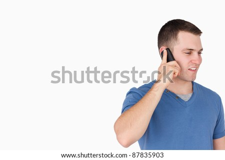 Handsome man on the phone against a white background - stock photo
