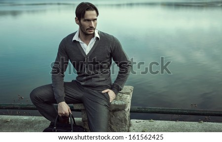 Handsome man on the river - stock photo
