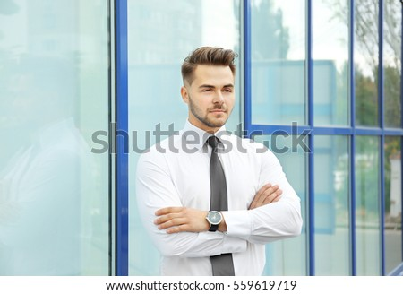 Handsome man on windows background