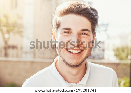 Handsome man outdoors portrait - stock photo