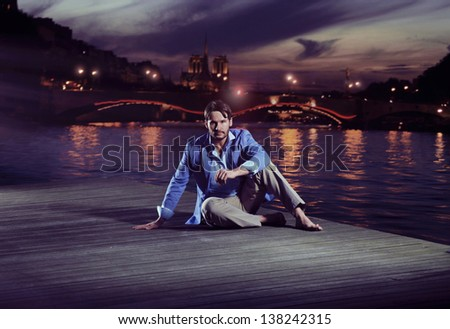 Handsome man over evening night city background