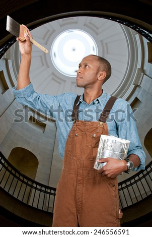 Handsome man painter cutting in with a brush - stock photo