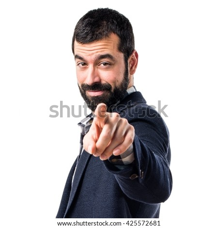 Handsome man pointing to the front - stock photo
