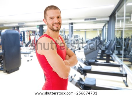 Handsome man portrait at the gym smiling - stock photo