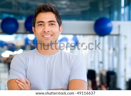Handsome man portrait at the gym smiling