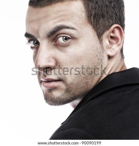 Handsome man portrait looking back on white background - stock photo