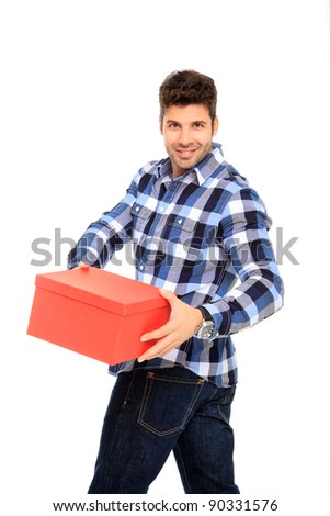 handsome man portrait with a red box in his hands