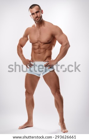 Handsome man posing in underwear on white background - stock photo