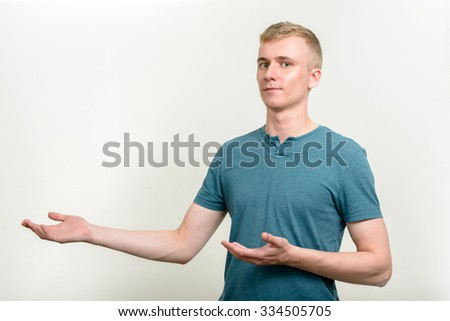 Handsome man presenting - stock photo