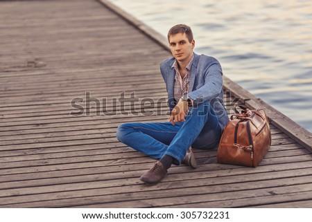 Handsome man resting - stock photo
