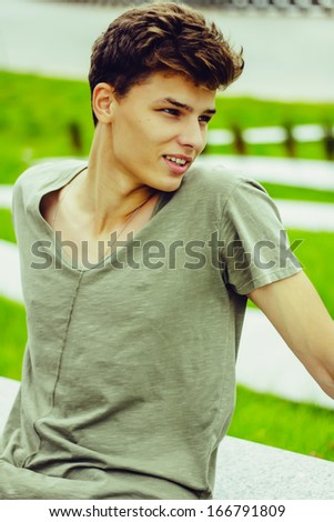 Handsome man resting outdoors - stock photo