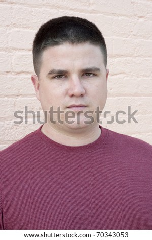 Handsome Man Serious Expression Portrait Taken Outdoors. - stock photo