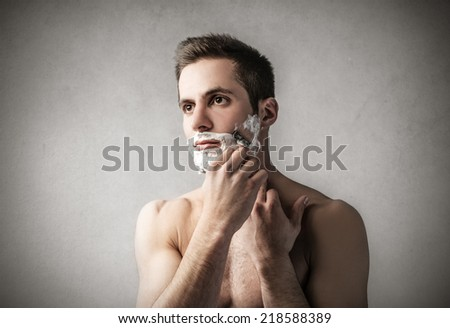 Handsome man shaving  - stock photo