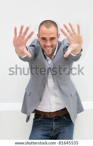 Handsome man showing hands to camera - stock photo