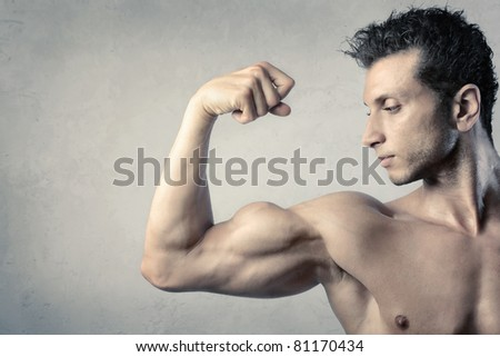 Handsome man showing his biceps - stock photo