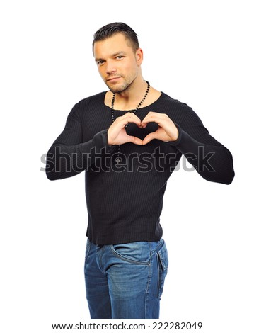 Handsome man shows heart with their hands. Isolated  - stock photo