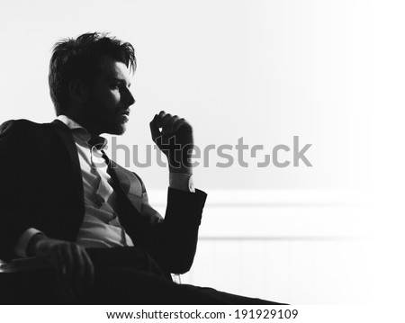 Handsome man silhouette - stock photo