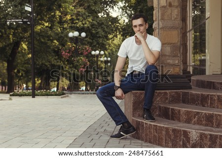 handsome man sitting in the park