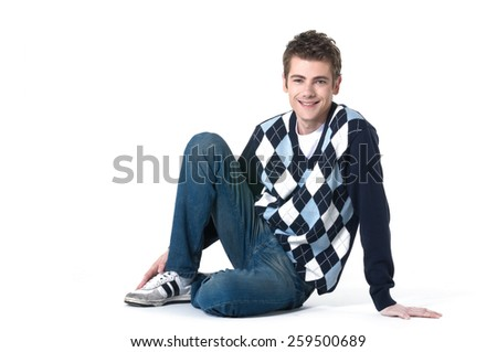 Handsome man sitting on the floor  - stock photo